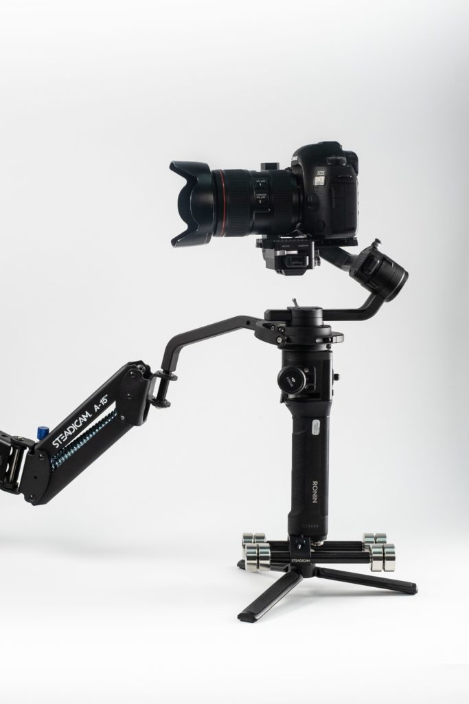 The Steadicam arm reduces vertical bounce by providing z-axis stabilization